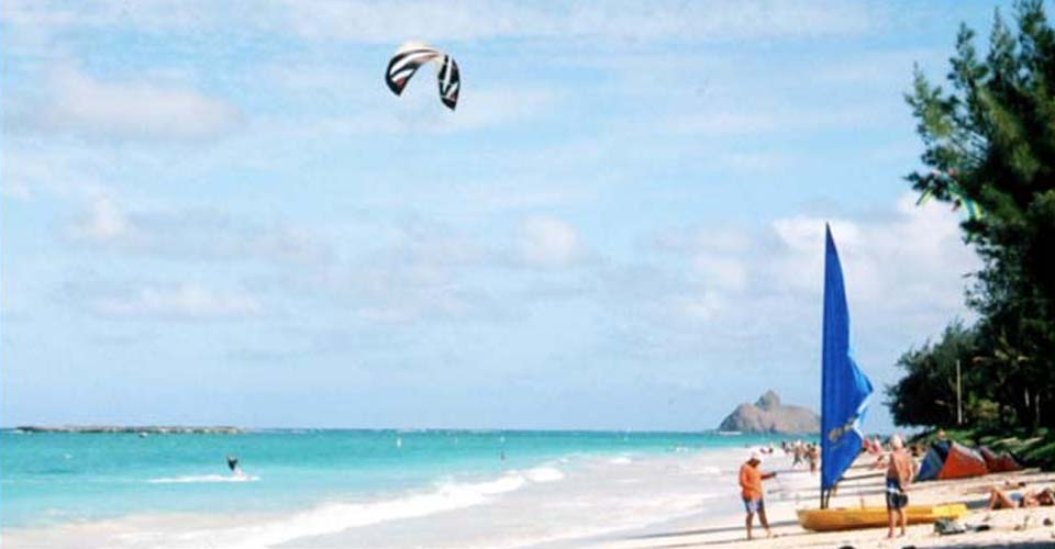 People enjoying various water sports at Kailua Beach.